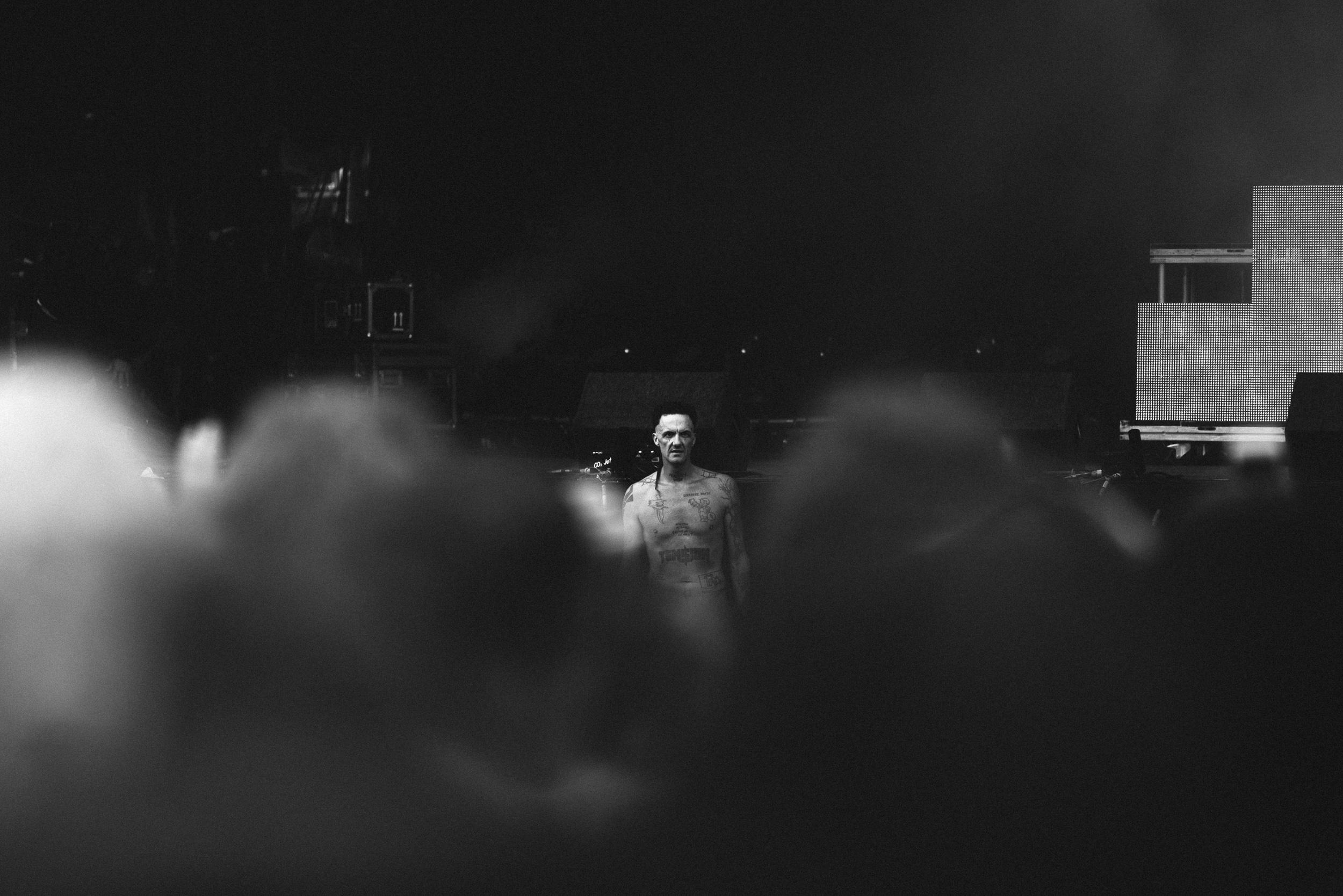Ninja of Die Antwoord at Leeds Festival by Adam Elmakias