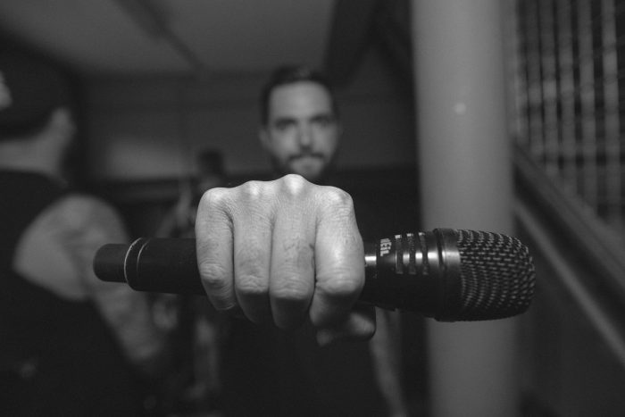 Before the show, always a fist pound - but only after mic is in hand