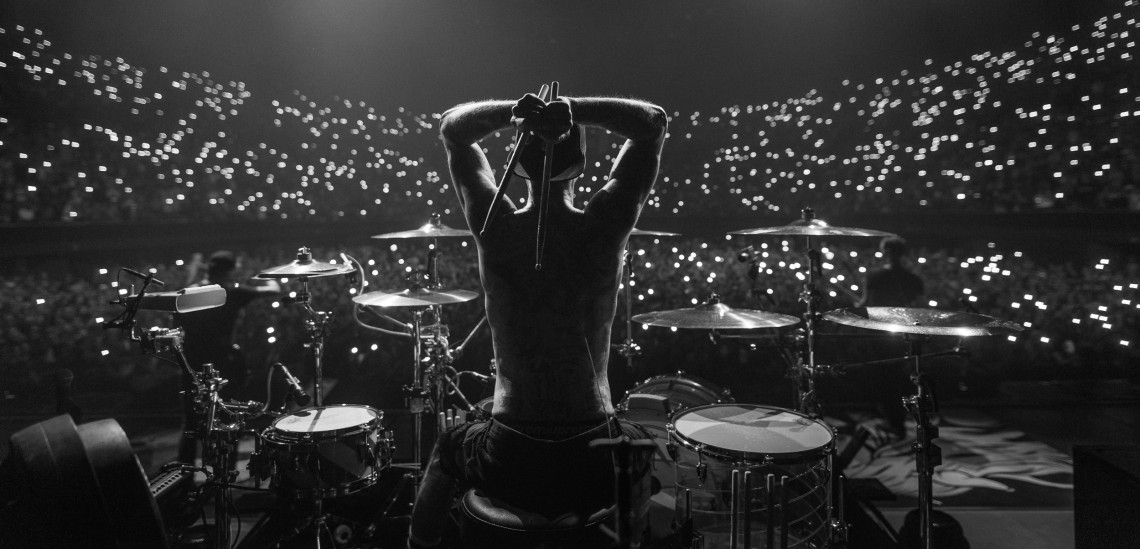 When To Use Black & White Instead Of Color? When color does not improve the image. Pictured: Travis Barker of Blink-182 at The Forum in Los Angeles, CA